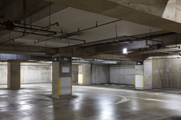 Parking garage underground interior, neon lights in dark