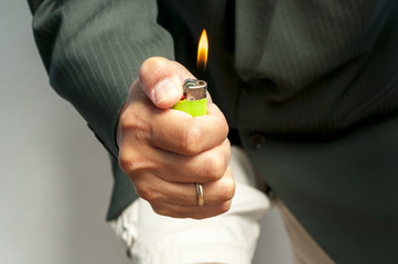 Hand and cigarete lighter