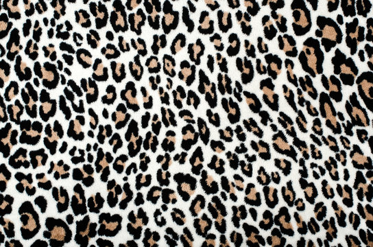 Brown and black leopard pattern.Fur animal print as background.