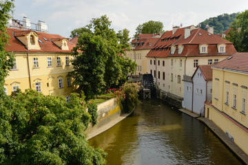 Prague river with waterwheel