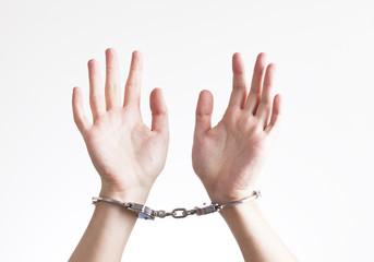 Arrested criminal hands in handcuffs