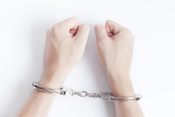Arrested criminal hands in handcuffs