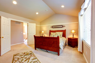 Light bedroom with vaulted ceiling