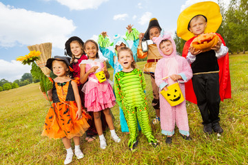 Wall Mural - Children in different Halloween costumes standing