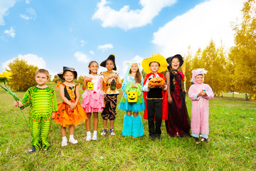 Wall Mural - Kids with Halloween costumes stand in row