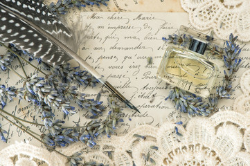 vintage ink pen, perfume, lavender flowers and old love letters