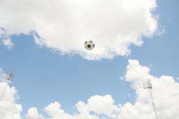 Football or soccer on blue sky.