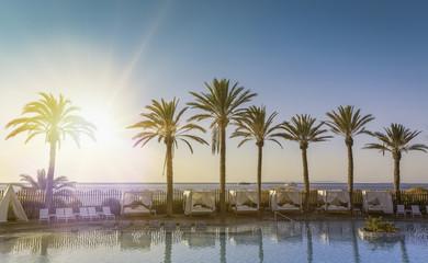 Beautiful sunrise at a beach resort in tropics