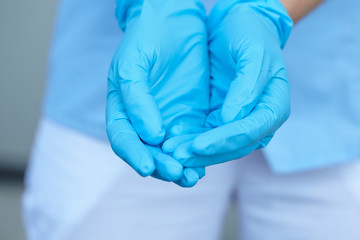 woman doctor in medical gloves
