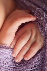 Small delicate little hand of newborn