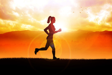 Silhouette of a woman jogging in the beautiful landscape
