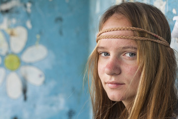 Portrait of young hippie girl, painting chamomile background