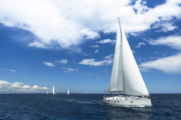 Sailboats participate in sailing regatta. Luxury Yachts.