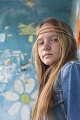 Portrait of young cute girl hippie, dirty background