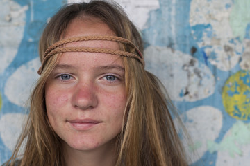 Closeup portrait of young girl hippie, dirty background
