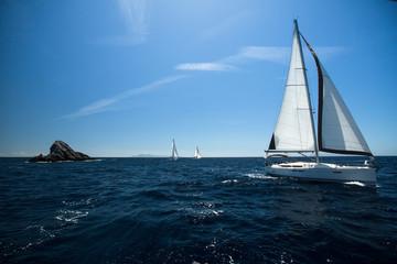 Sailing ship yachts in the sea.