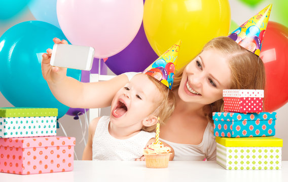selfie. birthday child with balloons, cake, gifts