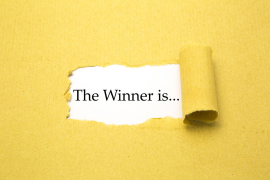Torn brown paper with The winner is... text