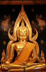 Buddha statue on brown background