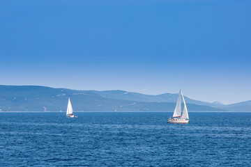 Two sailboats sailing on the Adriatic Sea in Croatia