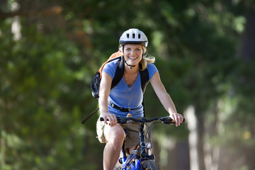 Portrait of woman riding bicycle