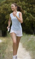 Woman running on rural path