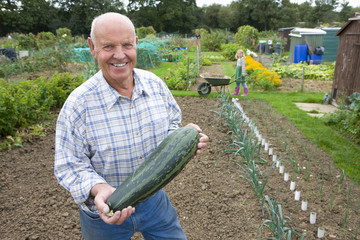 Man holding large squash
