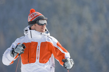 Serious skier in cap and goggles