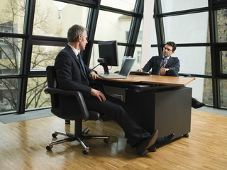 Two businessmen working in their office.