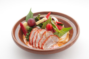 Sliced duck with chily, grapes and cherry tomato
