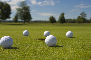 Close-up of golf balls on a golf course