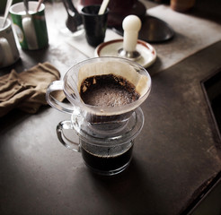 Cup of Dripping coffee on table
