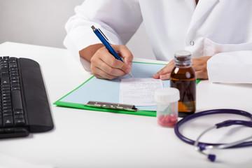 Doctor's hands delivering prescription