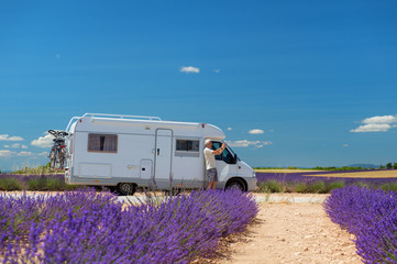 Traveler with mobile home at lavender fields in France