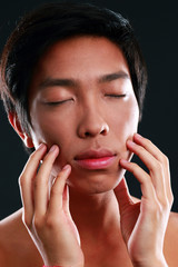 Man with eyes closed and hands on face