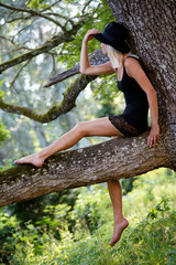 Young attractive slim woman posing on tree, summer enjoy