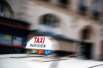 Taxi sign on fast moving cab fast