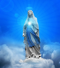 Madonna statue with blue sky and clouds background