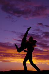 silhouette couple dancing lifting her up leg up