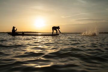 man 's fishing at sunset