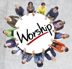 People Holding Hands Around the Word Worship