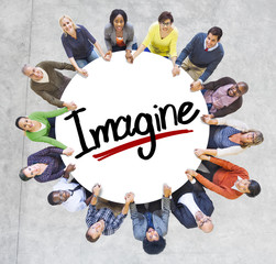 Group of People Holding Hands with Letter Imagine