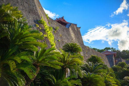 Smooth curve rampart of Shuri Castle and blue sky