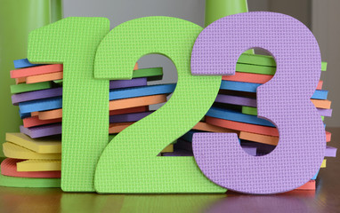 Colorful 1 2 3 numbers in a row of flat foam toys