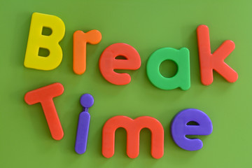 Close up of word Break Time in colorful plastic letters