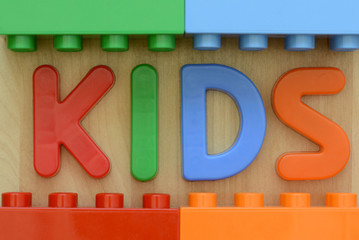 Close up of word KIDS in plastic letters amd blocks