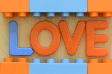 Close up of word LOVE in plastic letters and blocks