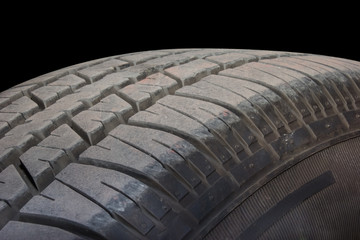 Close up of tire on black background