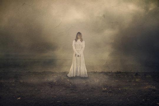 Horror scene with girl in the fog