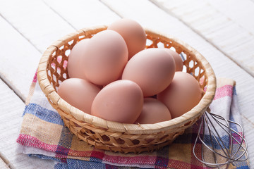 Chicken eggs on wooden background